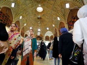 Iranians shop in Tehran's ancient Grand Bazaar on July 11, 2016. A year ago, a landmark nuclear deal with world powers led jubilant Iranians to dream of an end to isolation and economic hardship, but critics say US obstacles have soured those hopes. Despite many sanctions being lifted, the international banking system is still too nervous to work with Iran.   / AFP / ATTA KENARE / TO GO WITH AFP STORY BY ERIC RANDOLPH AND ALI NOORANI        (Photo credit should read ATTA KENARE/AFP/Getty Images)
